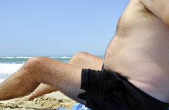 Fat man on the beach Royalty Free Stock Images