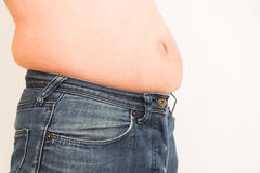Fat man with a big belly. Can`t wear his jeans Royalty Free Stock Images