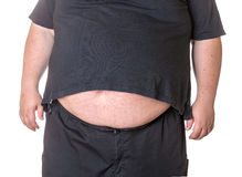 Fat man with a big belly. Close-up part of the body Stock Image