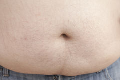 Fat man with a big belly, close-up part of the body Royalty Free Stock Photos