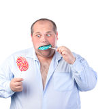 Fat Man in a Blue Shirt, Eating a Lollipop Stock Photography
