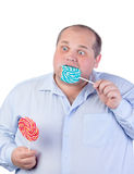 Fat Man in a Blue Shirt, Eating a Lollipop Stock Photo