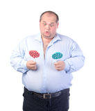 Fat Man in a Blue Shirt, with Lollipop Royalty Free Stock Images