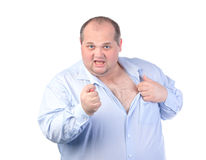 Fat Man in a Blue Shirt, Showing Obscene Gestures. Isolated Stock Image