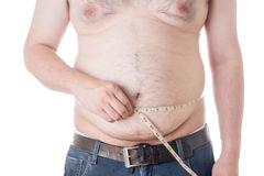 Fat man. Check out his body fat with measuring tape Stock Photo