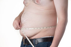 Fat man. Check out his body fat with measuring tape Stock Images