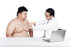 Fat man check up to doctor 2 Royalty Free Stock Image