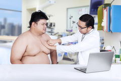 Fat man check up to doctor Stock Image