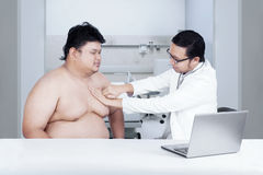 Fat man check up to doctor 1 Royalty Free Stock Photography