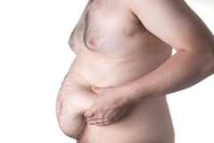 Fat man. Checking out his weight on white background Stock Photos