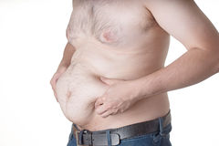 Fat man. Checking out his weight on white background Royalty Free Stock Images