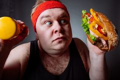 Fat man choise between sport and fastfood royalty free stock photo