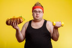 Fat man choise between sport and fastfood royalty free stock photos