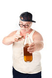 Fat man with cigar and bottle of beer. Obese man in tee shirt on white background with bottle and cigar. Vertical shot Royalty Free Stock Photography