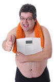 Fat man doing workout Stock Images
