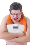 Fat man doing workout Royalty Free Stock Photo