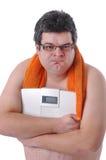 Fat man doing workout Royalty Free Stock Photos