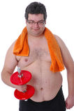 Fat man doing workout with dumbbells Royalty Free Stock Photos