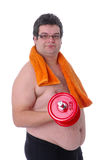 Fat man doing workout with dumbbells Stock Photo
