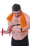 Fat man doing workout with dumbbells Royalty Free Stock Photography