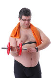 Fat man doing workout with dumbells Royalty Free Stock Image