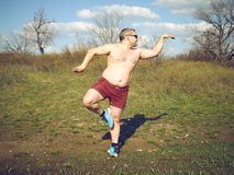 Fat man doing yoga Royalty Free Stock Photography