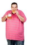 Fat man drinking beer and eating hamburger stock photography