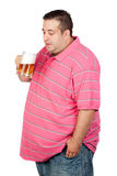 Fat man drinking a jar of beer Royalty Free Stock Photography