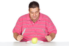 Fat man eating a apple Royalty Free Stock Photos