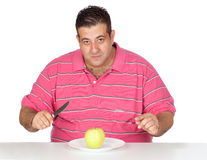 Fat man eating a apple Stock Photography