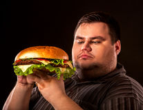 Free Fat Man Eating Fast Food Hamberger. Breakfast For Overweight Person. Royalty Free Stock Photos - 90838108