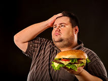 Free Fat Man Eating Fast Food Hamberger. Breakfast For Overweight Person. Royalty Free Stock Images - 96358209