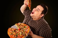 Fat man eating fast food slice pizza . Breakfast for overweight person. Diet failure of fat man eating fast food slice pizza on plate. Breakfast for hungry stock image