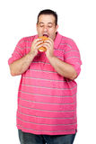 Fat man eating a hamburger Royalty Free Stock Photos