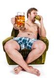 Fat man eating hamburger Stock Photo