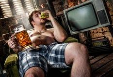 Fat man eating hamburger stock photography