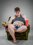 Fat man eating hamburger Royalty Free Stock Image