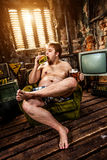 Fat man eating hamburger Stock Images
