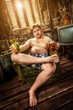 Fat man eating hamburger Stock Images