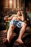 Fat man eating hamburger Royalty Free Stock Photo
