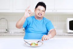 Fat man eating salad Royalty Free Stock Photo