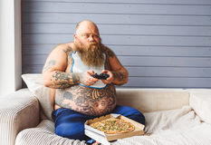 Fat man entertaining at home Royalty Free Stock Photo