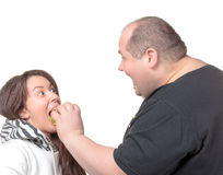 Fat Man Feeding a Girl a Burger Royalty Free Stock Images