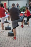 Fat Man in Fitness Class: Workout with Free Standing Boxing Punc. H Bag and Speed Ball Royalty Free Stock Images