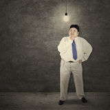 Fat man getting bright idea Royalty Free Stock Photo
