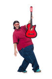 Fat man with guitar isolated on white Royalty Free Stock Images