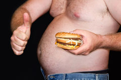 Fat man with hamburger Stock Image