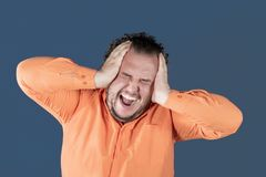 A fat man has high blood pressure and headache. Overweight and health problems stock photo