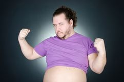 Funny fat guy with a big belly. Fat man. Health, sports and diet royalty free stock photography