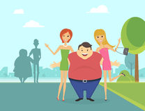 Fat man with his thin girlfriends in the park Stock Photo